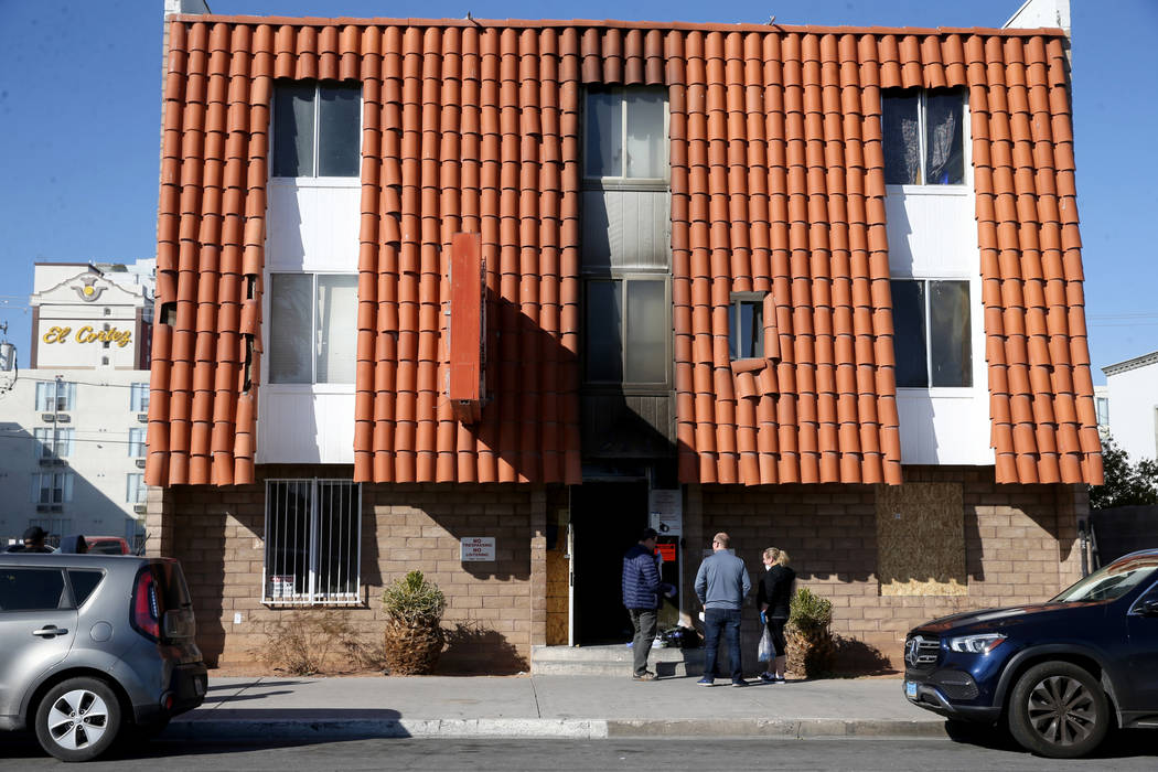 Investigators gather evidence at the Alpine Motel Apartments in Las Vegas on Tuesday, Jan. 14, ...