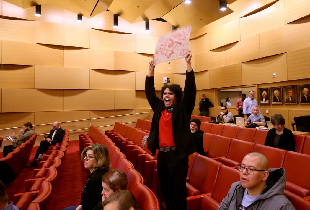 Jonas Rand of Las Vegas chants at the start of a Las Vegas City Council meeting Wednesday, Jan. ...