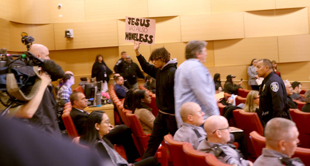 Jonathan Conlan of Las Vegas is escorted out at the start of a Las Vegas City Council meeting W ...