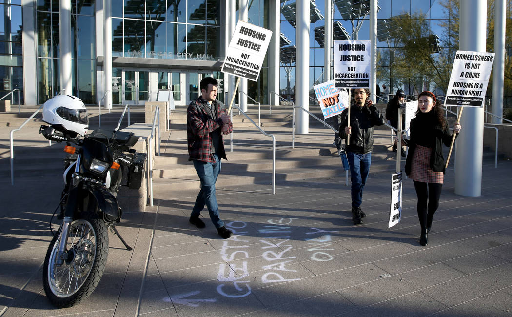 Daniel Weber, from left, Frank Lopez and Annelise Friedman, all of Las Vegas, protest before th ...