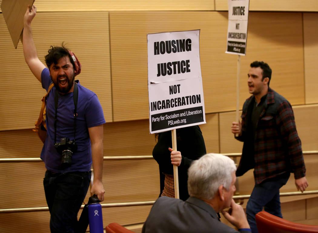Merrick Haji-Sheikh, from left, Annelise Friedman and Daniel Weber, all of Las Vegas, chant as ...