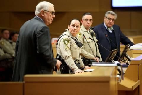 Clyde DeWitt, attorney for owner owner RTB, Inc., left, argues against closing Fremont East nig ...