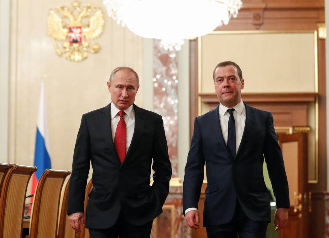 Russian President Vladimir Putin, left, and Russian Prime Minister Dmitry Medvedev walk prior t ...