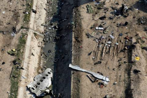 In this Wednesday, Jan. 8, 2020 photo, wreckage from a Ukrainian plane is seen on the ground a ...