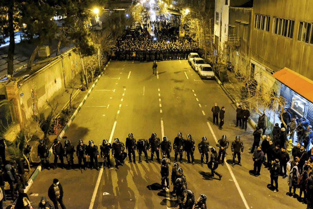 In this photograph taken Saturday, Jan. 11, 2020, Iranian police officers take position while p ...