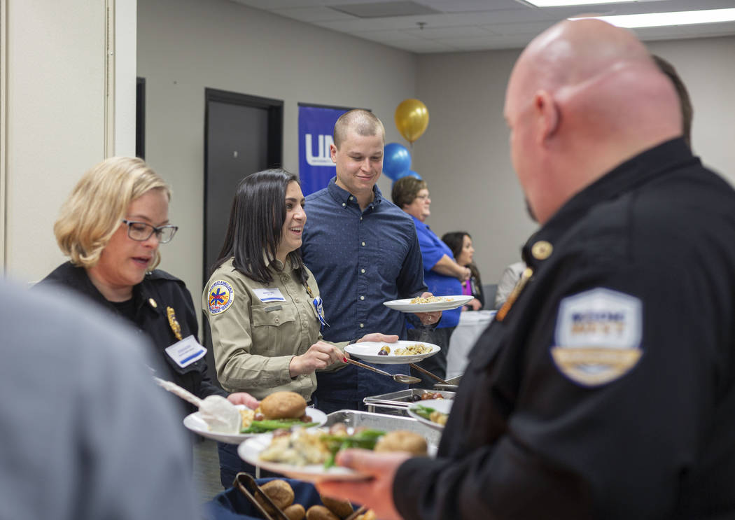 Emergency medical service providers receive lunch during a UMC luncheon to recognize their resp ...