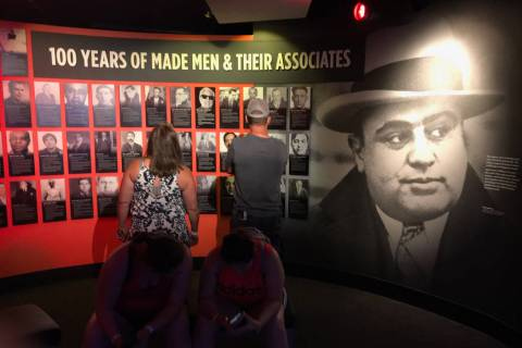 A wall of crime figures features Al Capone and others of his era at The Mob Museum. (Herb Jaffe)