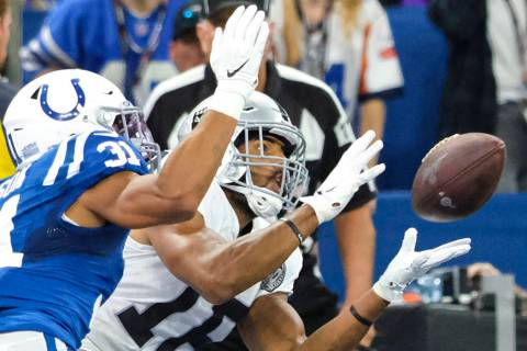 Oakland Raiders wide receiver Tyrell Williams (16) makes a catch for a touchdown in front of In ...