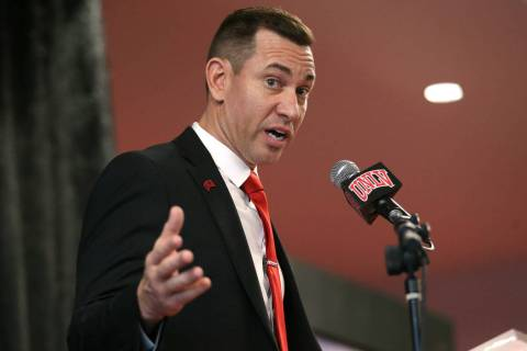 UNLV's new football head coach Marcus Arroyo speaks during a press conference at UNLV's Fertitt ...
