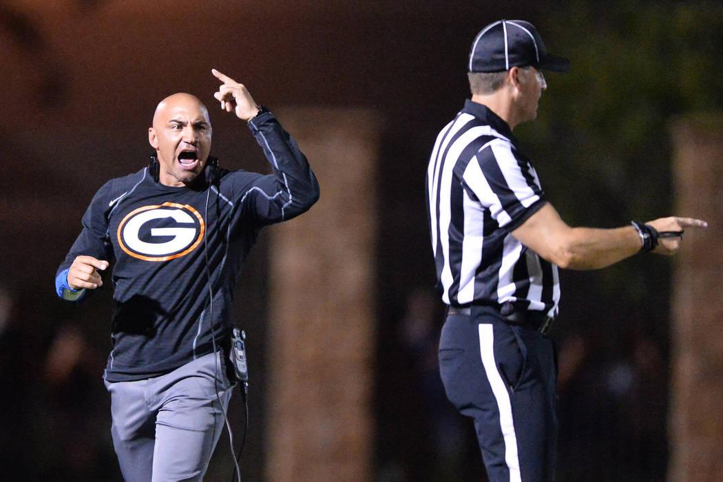 Bishop Gorman head coach Kenny Sanchez argues a call during the Bishop Gorman High School Kahuk ...