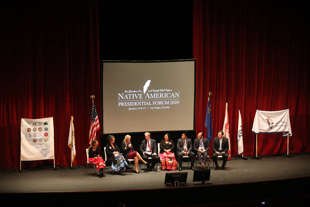 Democratic presidential candidate Tom Steyer, center, answers a questions at a Native American ...