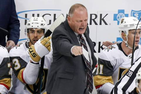 Vegas Golden Knights' Gerard Gallant, center, yells towards an official during the third period ...
