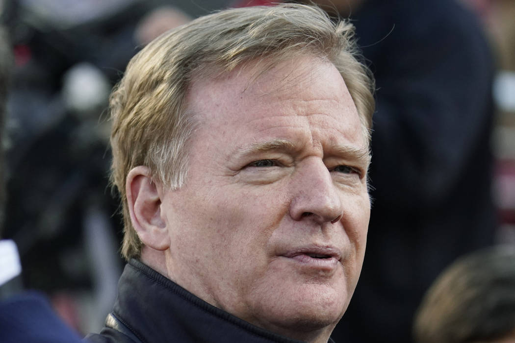 NFL Football Commissioner Roger Goodell watches warmups before an NFL divisional playoff footba ...