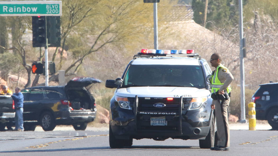 Las Vegas police investigate near Rainbow Boulevard and Darby after an officer-involved shootin ...