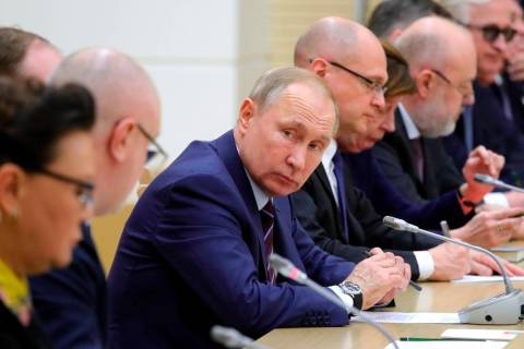 Russian President Vladimir Putin attends a meeting on drafting constitutional changes at the No ...