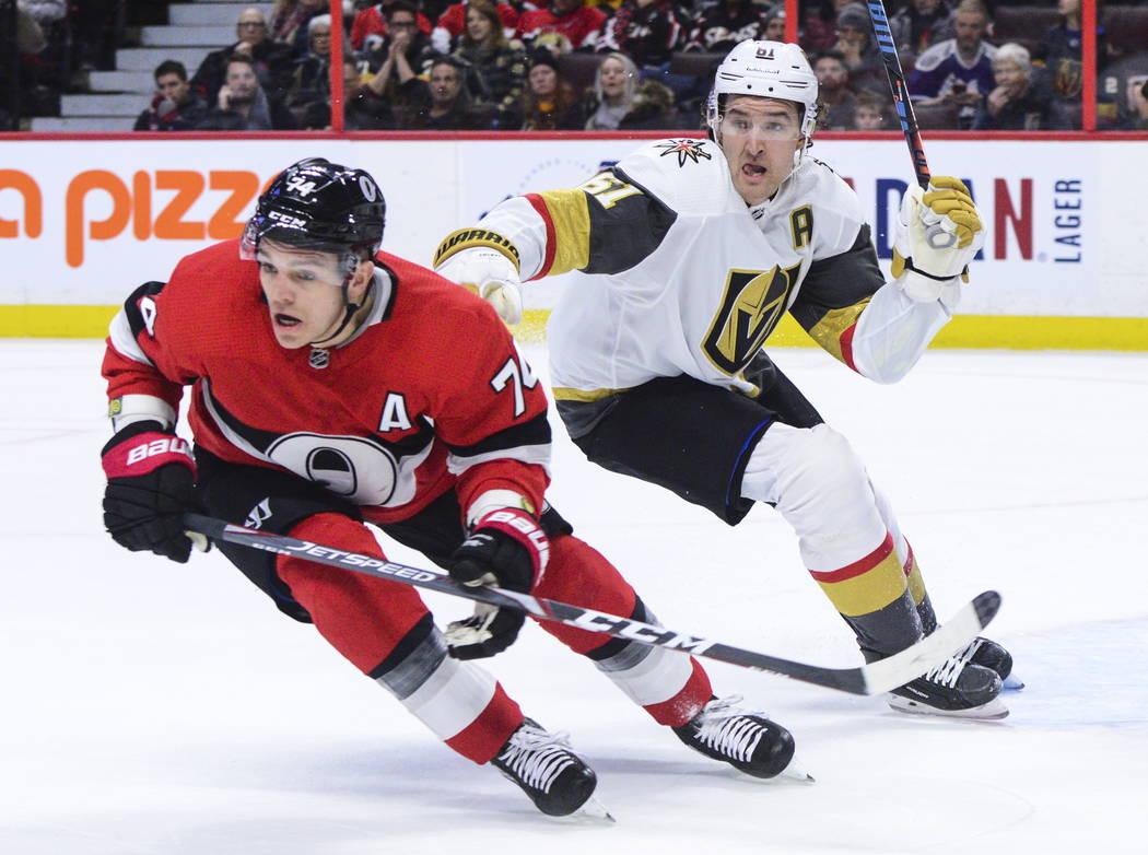 Vegas Golden Knights right wing Mark Stone (61) gives Ottawa Senators defenseman Mark Borowieck ...