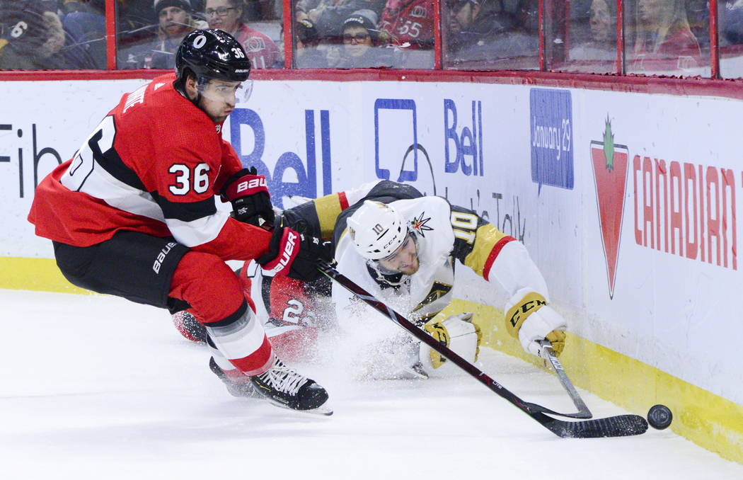 Vegas Golden Knights Nicolas Roy (10) fights for the puck against Ottawa Senators Colin White ( ...