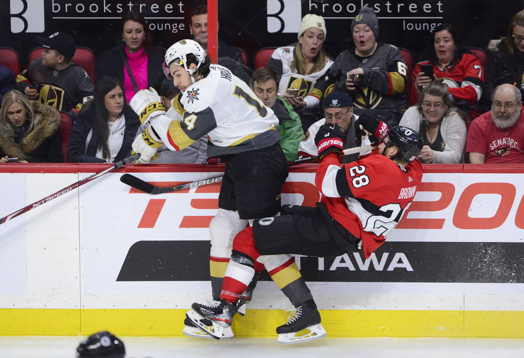 Fans react to Vegas Golden Knights defenseman Nicolas Hague (14) hitting Ottawa Senators right ...
