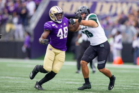 Bishop Gorman graduate Edufuan Ulofoshio, a walk-on at the University of Washington who grew up ...