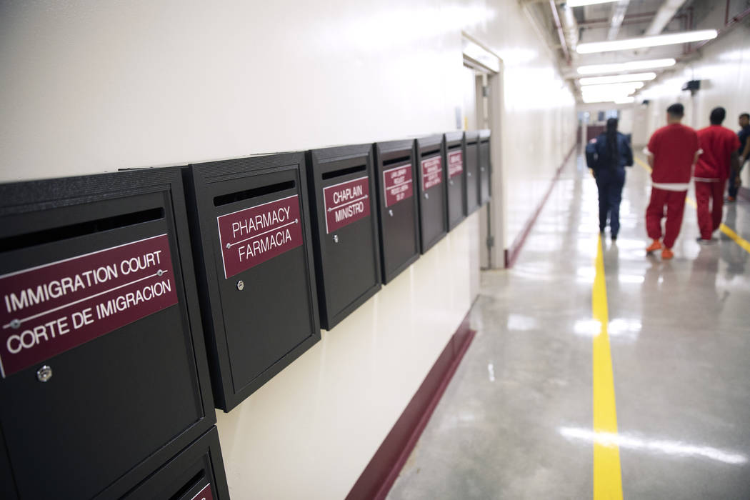 Mail boxes for various departments line a hallway as detainees walk through the Stewart Detenti ...