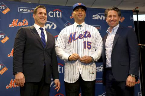 New York Mets manager, Carlos Beltran, center, poses for a picture with general manager Brodie ...
