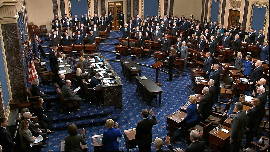 In this image from video, presiding officer Supreme Court Chief Justice John Roberts swears in ...