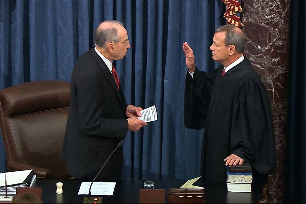In this image from video, President Pro Tempore of the Senate Sen. Chuck Grassley, R-Iowa., swe ...