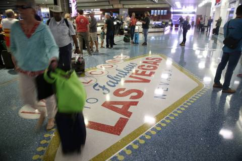 Passengers at baggage claim in Terminal 1 at McCarran International Airport in Las Vegas, Oct. ...