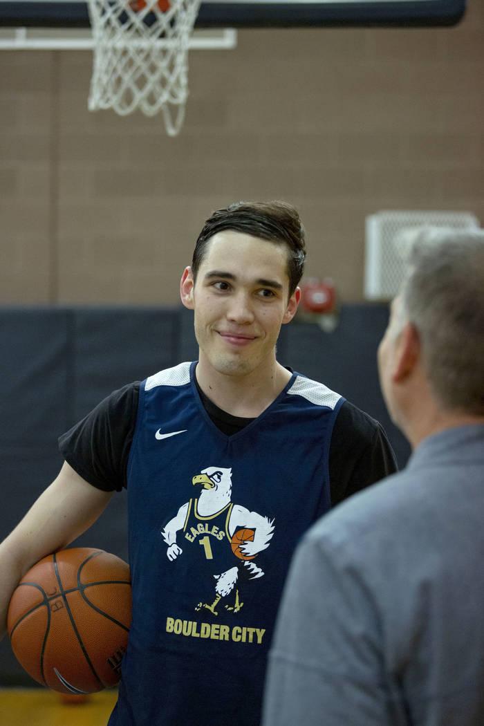 Junior Ethan Speaker, left, speaks with Boulder City basketball coach John Balistere during pra ...