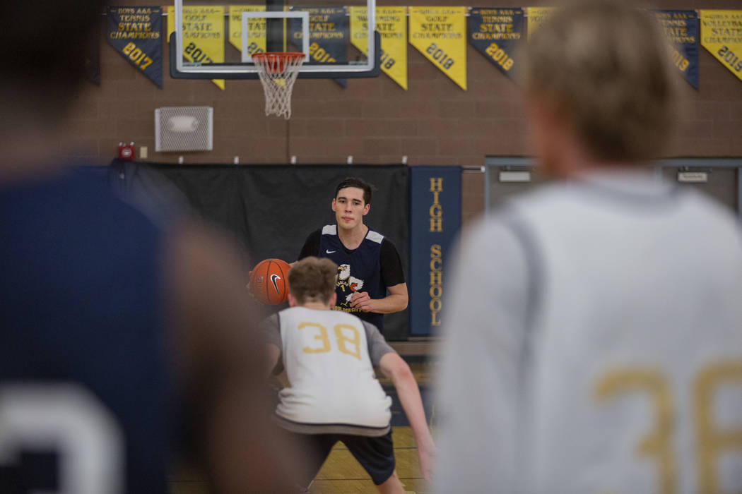 Junior Ethan Speaker (26) leads a drill during practice at Boulder City High School on Wednesda ...