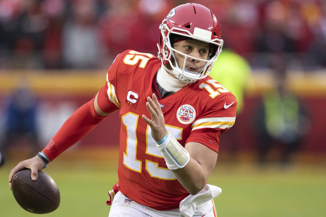 Kansas City Chiefs quarterback Patrick Mahomes scrambles for yardage during an NFL divisional p ...