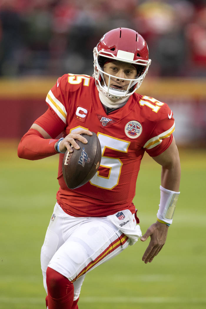 Kansas City Chiefs quarterback Patrick Mahomes scrambles for a first down during an NFL divisio ...