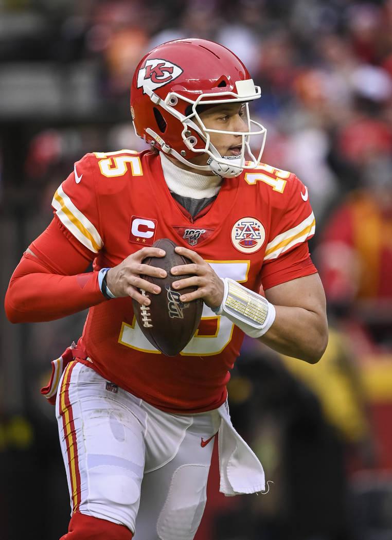 Kansas City Chiefs quarterback Patrick Mahomes (15) scrambles against the Houston Texans during ...
