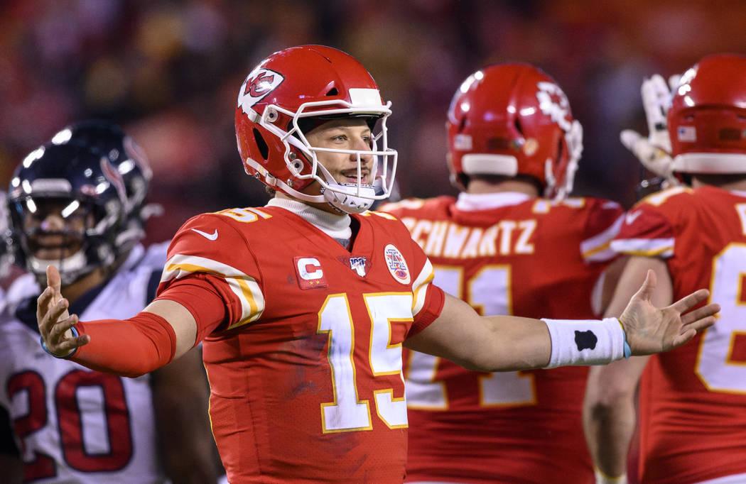 Kansas City Chiefs quarterback Patrick Mahomes (15) celebrates as time runs out in their win ov ...