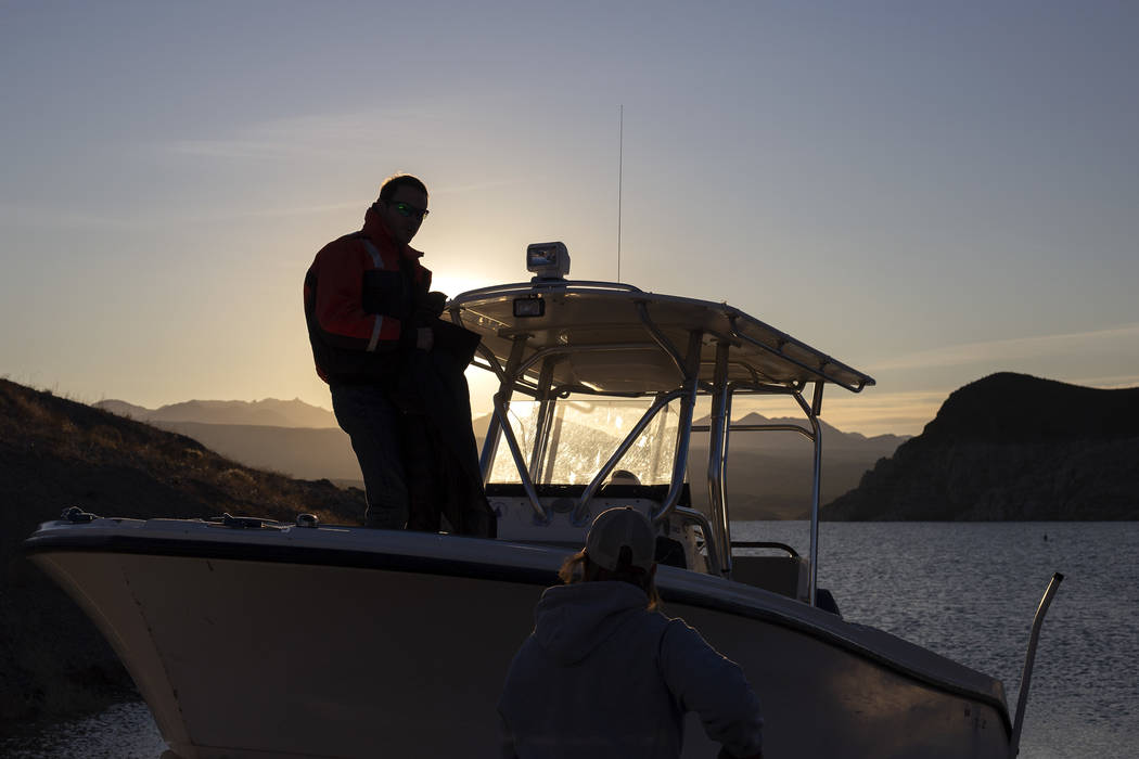 Alex Swicegood and Carrie Norman, who both work at the National Park Service, get a boat ready ...