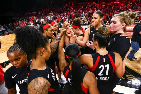 Members of the Las Vegas Aces huddle after losing to the Washington Mystics in a WNBA semifinal ...