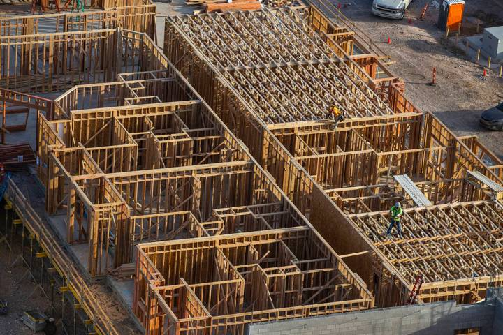 Framing continues on a new 287-unit apartment complex by developer Jonathan Fore under construc ...