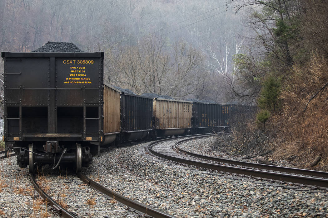 In this Tuesday, Jan. 14, 2020, photo, train cars filled with coal sit idle as miners, who say ...