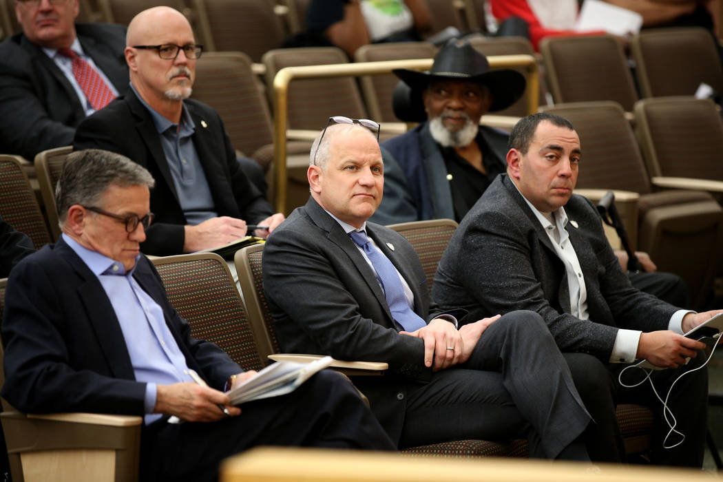 Raiders President Marc Badain, center, is flanked by Las Vegas Stadium Co. Chief Operating Offi ...