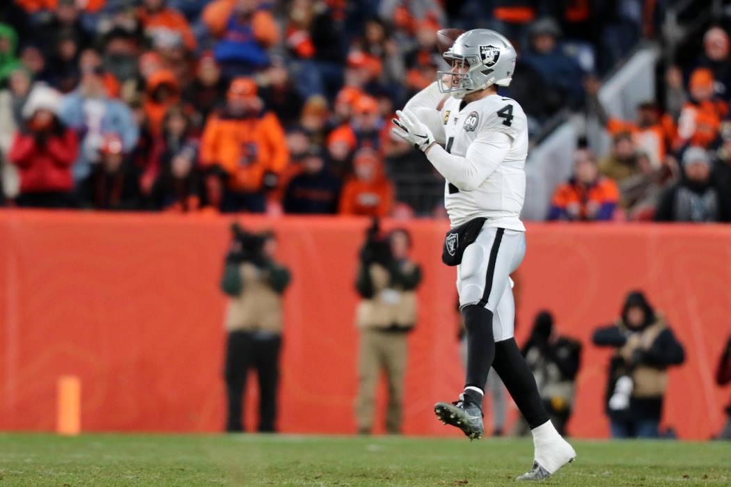 Oakland Raiders quarterback Derek Carr (4) prepares to throw the football during the fourth qua ...