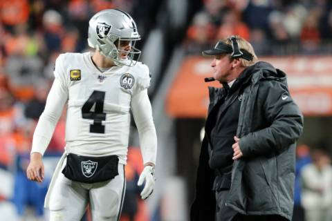 Oakland Raiders quarterback Derek Carr (4) and head coach Jon Gruden discuss a play call during ...