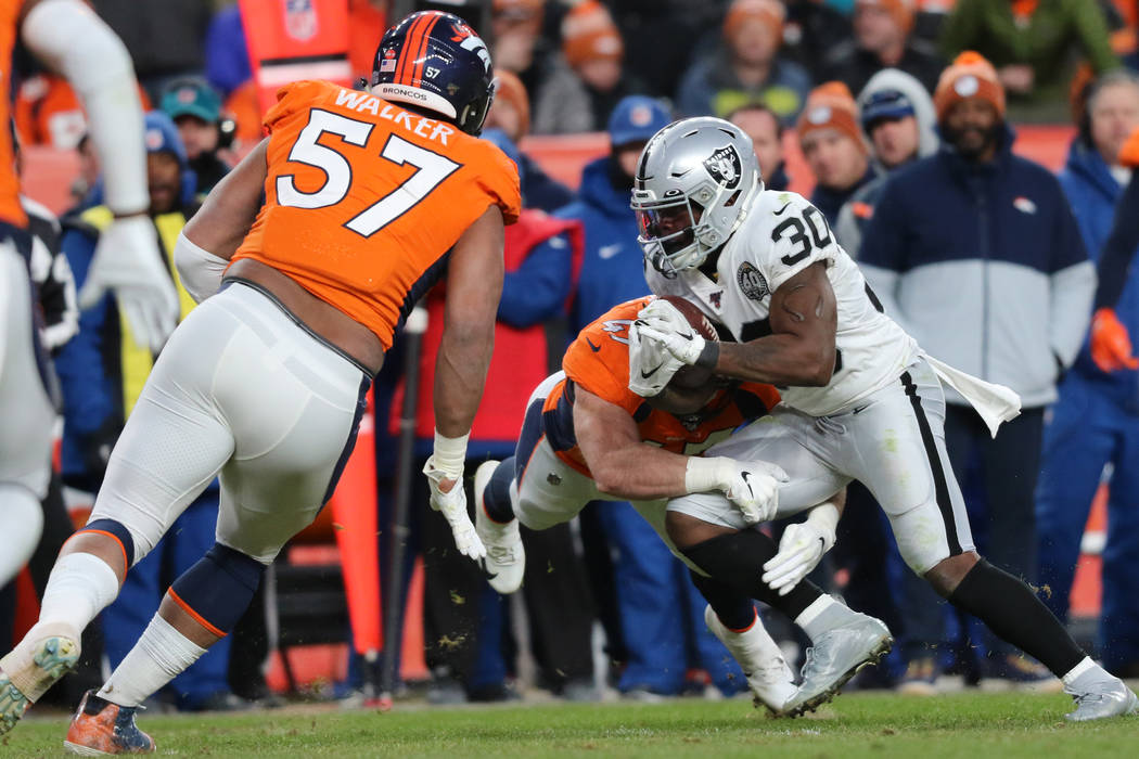 Denver Broncos inside linebacker Josey Jewell (47) tackles Oakland Raiders running back Jalen R ...