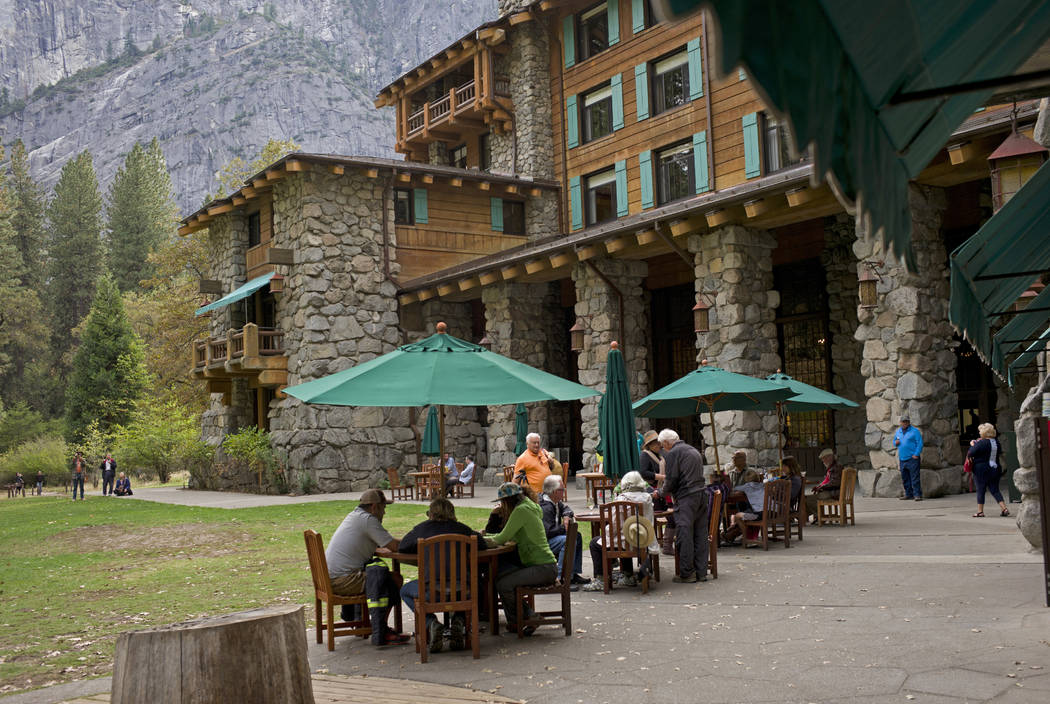 FILE - In this Oct. 24, 2015, file photo, people dine outside the Ahwahnee hotel in Yosemite Na ...