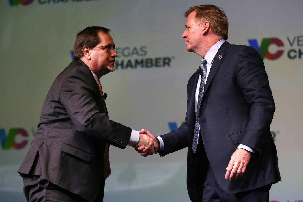 NFL Commissioner Roger Goodell, right, shakes hands with Las Vegas Review-Journal sports editor ...