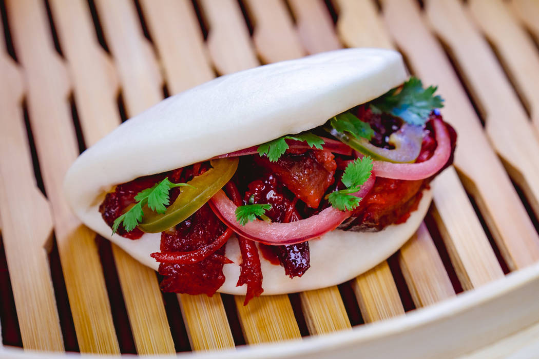 This char siu pork bao with barbecued pork, pickled red onions and jalapeño can be found a ...