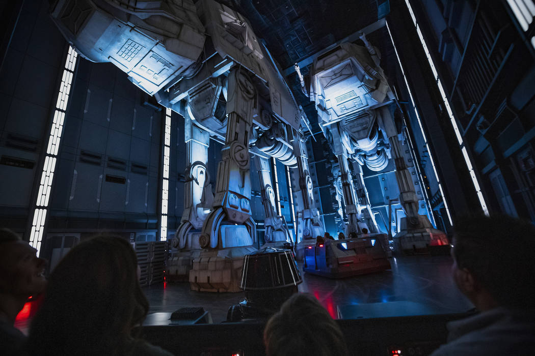 """Guests race past massive AT-AT walkers aboard a First Order Star Destroyer as part of """"Star War ..."""