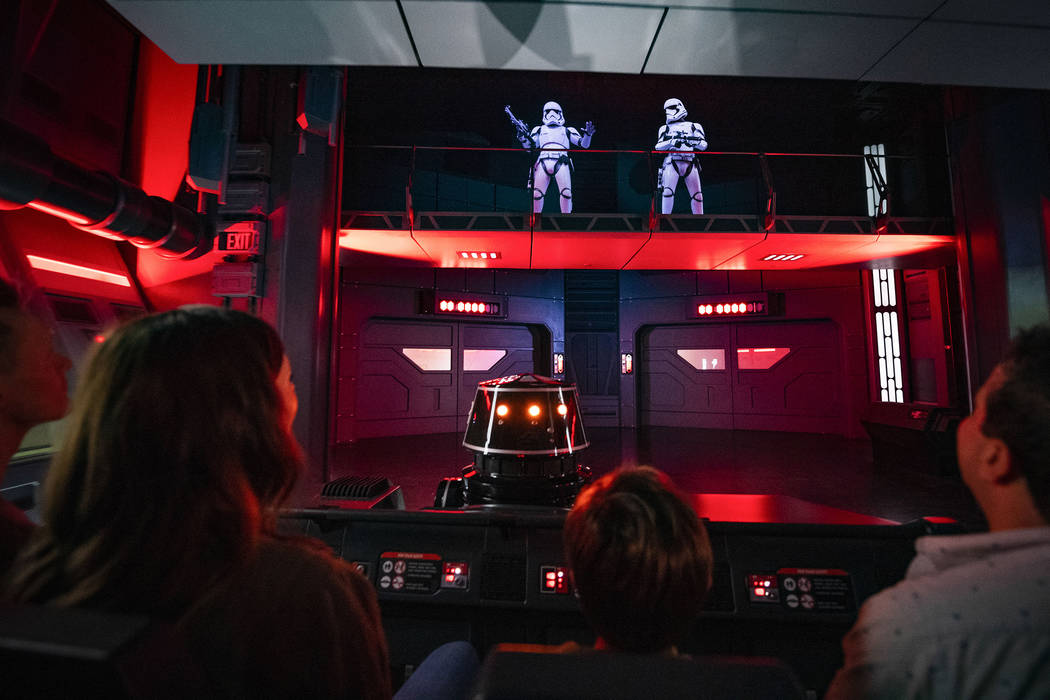 Guests flee First Order Stormtroopers onboard a Star Destroyer as part of Star Wars: Rise of th ...
