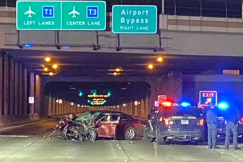 Nevada Highway Patrol troopers investigate a vehicle involved in a fatal, wrong-way crash on Pa ...