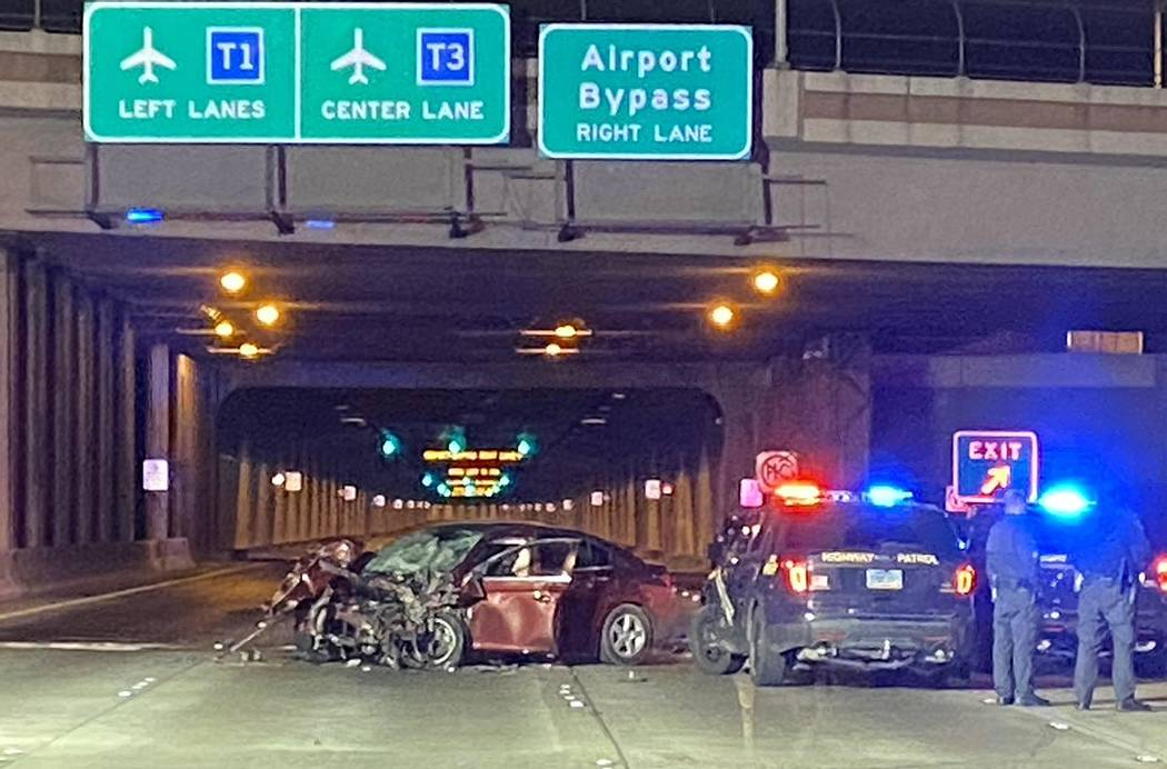 Nevada Highway Patrol troopers investigate a Chevy Cruz involved in a fatal, wrong-way crash on ...