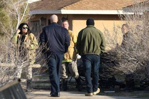 Las Vegas police and Las Vegas fire officials investigate after a person died in a shed fire at ...